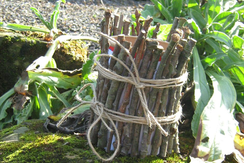 Make a pencil holder using twigs