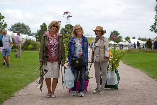 Visitors with flower show purchases